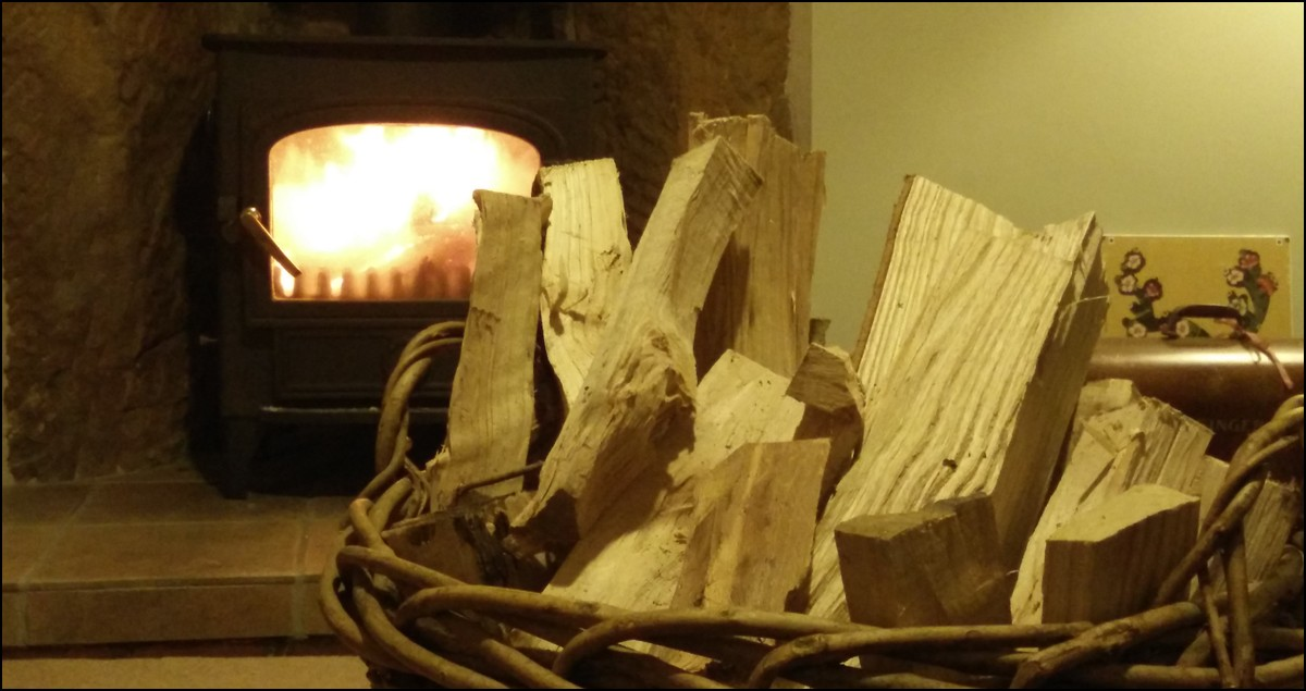 Basket of wood and log burner.